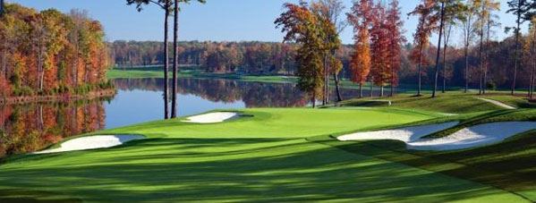 View from above the beautiful Kinlock Golf Course down to a lake surrounded by stunning tree's in true autumn colors.