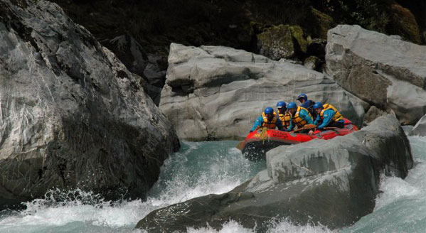 The Perth Rivers batters the raft with massive boulders as the rafters make their way down one of New Zealands most beautiful rivers.