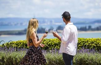 Couple drinking wine on waiheke island