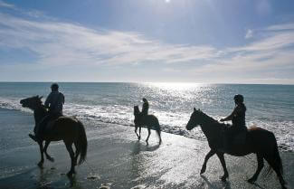 Riding on beach