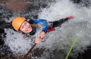 Get very wet canyoning on the West Coast.