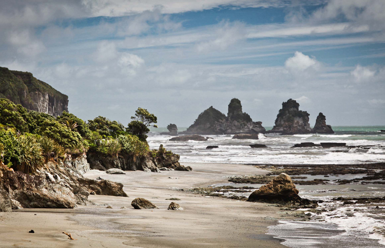 New Zealands West Coast and its wild pounding waves and craggy cliff faces.